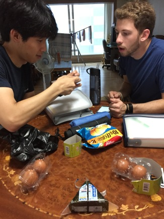 Our roommate teaching us the magical method of unwrapping these samgak-kimbap. Danny's moment of realization.