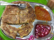 This is chicken murtabak, served with syrup-pickled onions and curry. It's basically a stuffed and folded pancake. It was amazing.